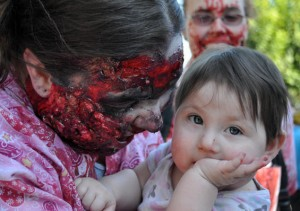 zombie eating baby at zombie walk