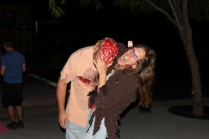 zombie eating brains at zombie walk