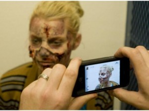 applying zombie makeup for a sexy zombie