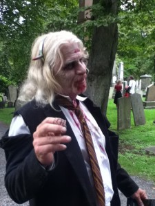 old zombie in suit at zombie walk