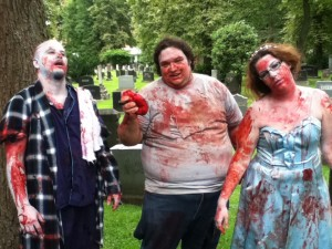 fat zombies eating at zombie walk